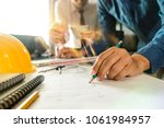 two colleagues discussing data...   Shutterstock . vector #1061984957