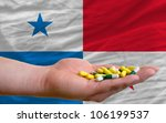 man holding capsules in front... | Shutterstock . vector #106199537