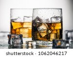 whiskey in a glass with ice on... | Shutterstock . vector #1062046217