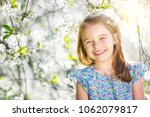 happy little girl playing in... | Shutterstock . vector #1062079817
