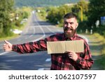 hipster try to stop car with... | Shutterstock . vector #1062107597