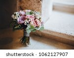 bouquet of flowers and greens... | Shutterstock . vector #1062127907