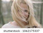 blonde woman portrait outdoor.... | Shutterstock . vector #1062175337