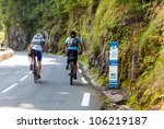 EAUX-BONNES,FRANCE-JUL 15:Two amateur cyclists climbing the road to Col D'Aubisuqe,in Pyrenees Mountains, before passing the peloton during the 13 stage of Le Tour de France on July 15 2011. - stock photo