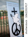 Small photo of Aldermaston, United Kingdom, 1st April 2018:- CND peace banners by the main gate to the AWE where Britains nuclear warheads are made, on the 60th anniversary of the first CND march in 1958