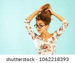 funny pretty young woman in... | Shutterstock . vector #1062218393