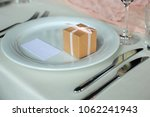 Small photo of serving meals in a restaurant for one person with a boarding card