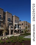 row of new brick townhomes near ... | Shutterstock . vector #1062254723