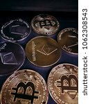 Small photo of BTC , ETH coins on black background