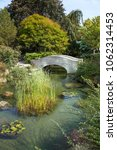 stone bridge over a creek in a... | Shutterstock . vector #1062314453