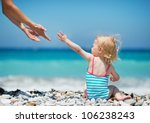 Baby pulling hands to mother - stock photo