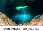 diving at the cenote jardin del ... | Shutterstock . vector #1062529763