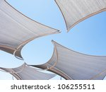 Awnings against the blue sky background - stock photo
