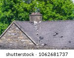 slate roof on a stone house  in ... | Shutterstock . vector #1062681737