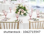 beautiful table setting with... | Shutterstock . vector #1062715547
