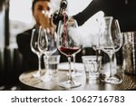 a close up shot of a sommelier... | Shutterstock . vector #1062716783