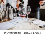 a close up shot of a sommelier... | Shutterstock . vector #1062717017
