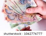 an hand holding romanian... | Shutterstock . vector #1062776777