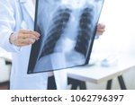 woman doctor looking at x ray... | Shutterstock . vector #1062796397