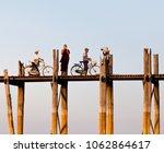 Small photo of AMARAPURA, MANDALAY DIVISION, MYANMAR - JANUARY 13, 2011: People walking on famous U Bein teak bridge in Amarapura, Mandalay Division of Myanmar