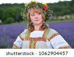 peasant girl in a flowers... | Shutterstock . vector #1062904457