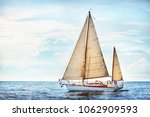 Small photo of Vintage wooden two mast yacht (yawl) sailing in a open sea on a clear day