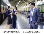 business man texting on mobile... | Shutterstock . vector #1062916553