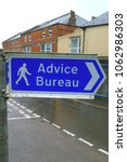 Small photo of Advice Bureau sign on the street in Axminster, Devon