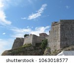 Small photo of clouds flit across the sky over the old walled town of Ulcinj, Montenegro
