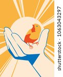 little bird in hand. vector... | Shutterstock .eps vector #1063043297