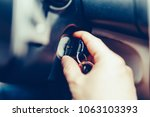 the driver of the man gets a... | Shutterstock . vector #1063103393
