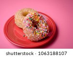 two glazed donuts  one with...   Shutterstock . vector #1063188107