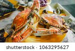 red crab fight in the dinner... | Shutterstock . vector #1063295627