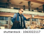 businessman checking the time... | Shutterstock . vector #1063322117