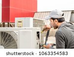a professional electrician man... | Shutterstock . vector #1063354583