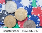 bitcoin on pile of casino chips ... | Shutterstock . vector #1063437347
