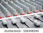 Sound mixer control, low angle shot with shallow depth field. - stock photo