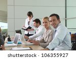 colleagues working at laptop... | Shutterstock . vector #106355927