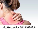 young woman scratching upper... | Shutterstock . vector #1063642073