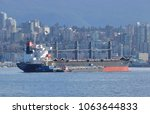 Small photo of VANCOUVER, BC/Canada - April 2, 2018: The Global Aglaia, a bulk carrier ship sailing under the Marshall Islands flag is anchored in Vancouver harbor on April 2, 2018.