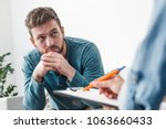 man with psychologist theraphy... | Shutterstock . vector #1063660433
