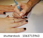 Small photo of Affixing of glitter on the newly painted nails