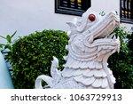 statue at wat duang dee in... | Shutterstock . vector #1063729913