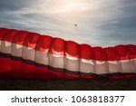 paragliding parashute on ground.... | Shutterstock . vector #1063818377