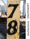 Small photo of Written Wording in Distressed State Typography Found Number Seventy Eight Seven Eight