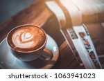 cup of latte on the table with...   Shutterstock . vector #1063941023
