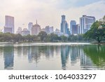 skyline view from lumpini park  ... | Shutterstock . vector #1064033297