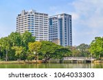 skyline view from lumpini park  ... | Shutterstock . vector #1064033303