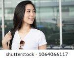 pretty young female passenger... | Shutterstock . vector #1064066117