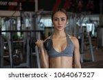 fitness woman weight lifting... | Shutterstock . vector #1064067527